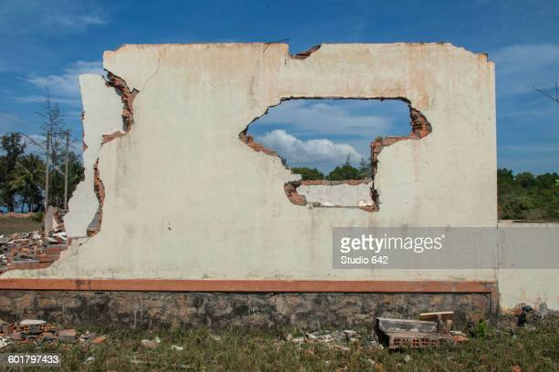 Walls of demolished house in rural field