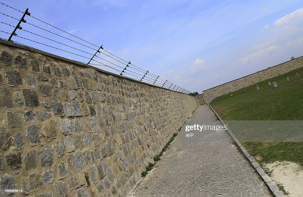 Walls with barbed wires are seen at World War II concentration camp of Mauthausen, on April 17, 2013.