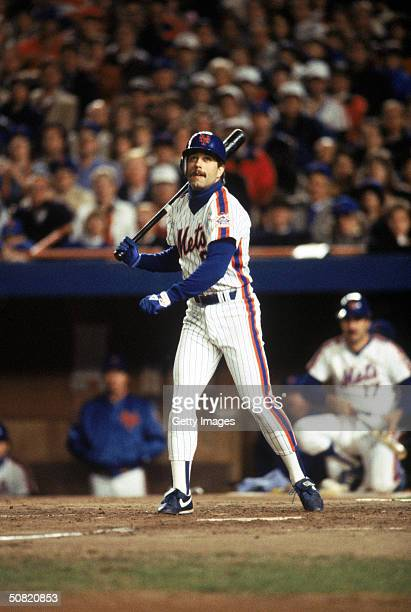 Wally Backman of the New York Mets watches a fly ball during Game7 of the1986 World Series against the Boston Red Sox at Shea Stadium on October 27...