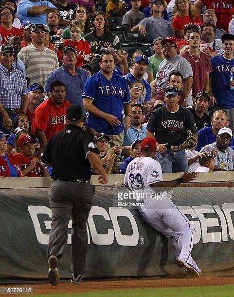 Wally Bell home plate umpire looks on as Adrian Beltre of the Texas Rangers runs for a pop fly but is late for the catch against the Oakland...