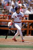 Wally Joyner of the California Angels watches the flight of the ball as he heads to first base at Anaheim Stadium in Anaheim California Joyner played...