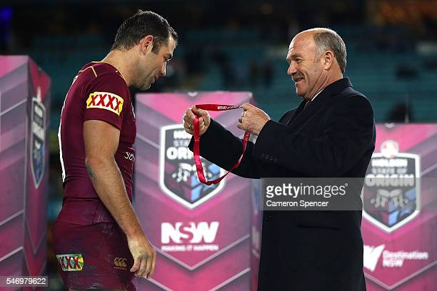 Wally Lewis awards Cameron Smith of the Maroons the Player of the Series during game three of the State Of Origin series between the New South Wales...