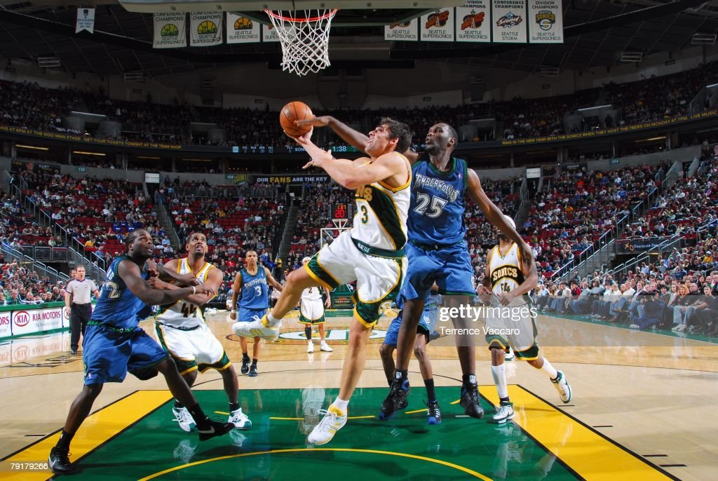 Wally Szczerbiak #3 of the Seattle SuperSonics goes up for a shot against Al Jefferson #25 of the Minnesota Timberwolves during the game at Key Arena on December 29, 2007 in Seattle, Washington. The Sonics won 109-90.