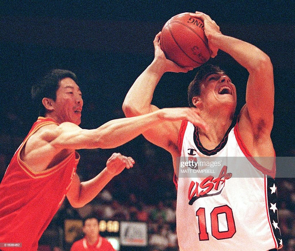 Wally Szczerbiak of the US R tries to keep the b