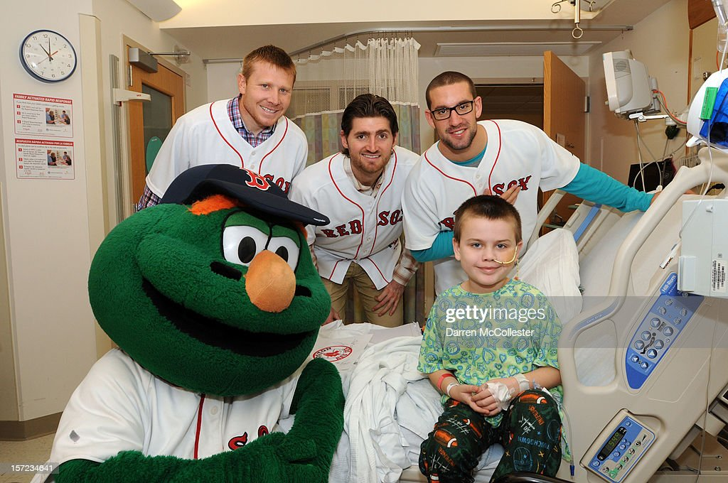 Wally The Green Monster, <a gi-track='captionPersonalityLinkClicked' href=/galleries/search?phrase=Mark+Melancon&family=editorial&specificpeople=4900198 ng-click='$event.stopPropagation()'>Mark Melancon</a>, <a gi-track='captionPersonalityLinkClicked' href=/galleries/search?phrase=Chris+Carpenter+-+Baseball+Player&family=editorial&specificpeople=208139 ng-click='$event.stopPropagation()'>Chris Carpenter</a> and Ryan Kalish of the Boston Red Sox visit Gary at Boston Children's Hospital on November 30, 2012 in Boston, Massachusetts.