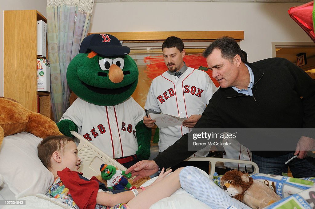Wally The Green Monster, Ryan Lavarnway and manager John Farrell of the Boston Red Sox visit Ian for the Holiday at Boston Children's Hospital on November 30, 2012 in Boston, Massachusetts.
