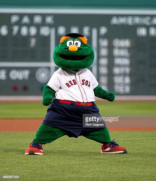 Wally the Green Monster the official mascot of the Boston Red Sox stands in the infield before a game between the Boston Red Sox and the Cleveland...