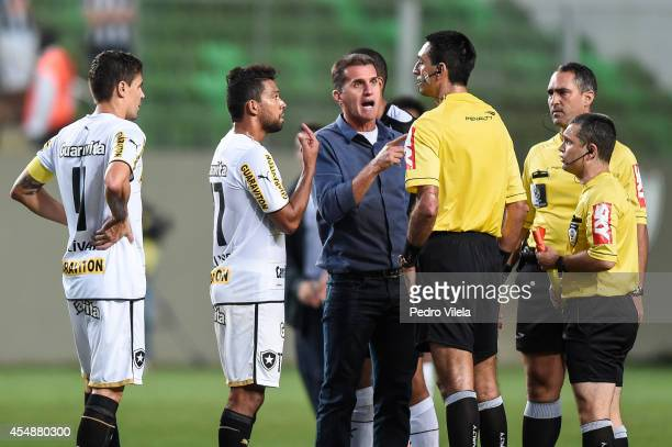 Wallyson and Vagner Mancini coach of Botafogo argues with the referee Flavio Rodrigues Guerra after a match between Atletico MG and Botafogo as part...