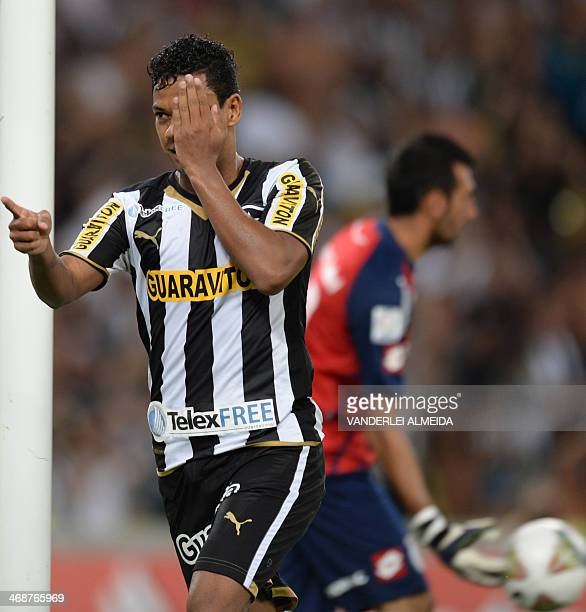 Wallyson of Brazilian Botafogo celebrates after scoring against Argentina's San Lorenzo during their Libertadores match at Mario Filho 'Maracana'...