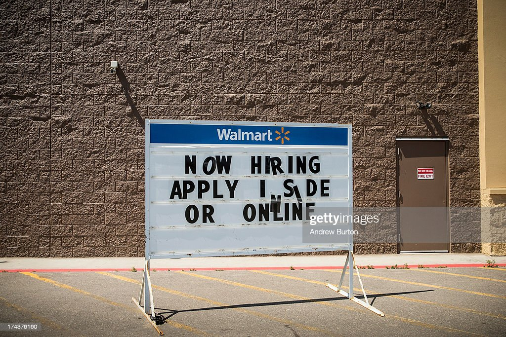 Walmart advertises a sign reading, 'Now Hiring, Apply Inside or Online' outside their store on July 24, 2013 in Williston, North Dakota. North Dakota is in the midst of a major oil boom, driving unemployment to just 3.1% - the lowest in the nation.