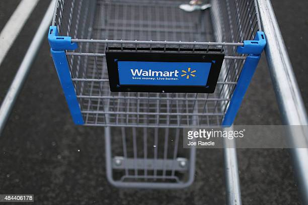 Walmart cart is seen on August 18 2015 in Miami Florida Walmart announced today that earnings fell in the second quarter due to currency fluctuations...