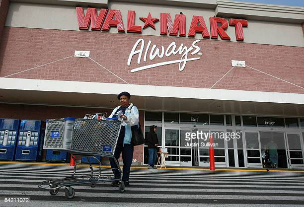 WalMart customer leaves a WalMart store January 8 2009 in Oakland California WalMart has posted weaker than expected same store sales for December...