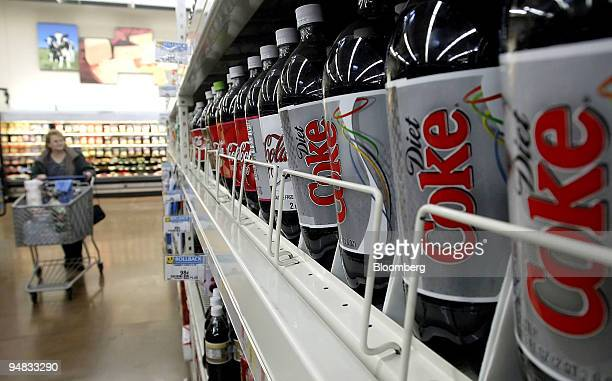 WalMart customer peruses the soda aisle past a display of CocaCola products Thursday March 2 in Grove City Ohio WalMart Stores Inc the world's...