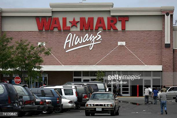 WalMart customers enter the store May 10 2007 in Oakland California US retailers are reporting slumping samestore sales for the month of April driven...