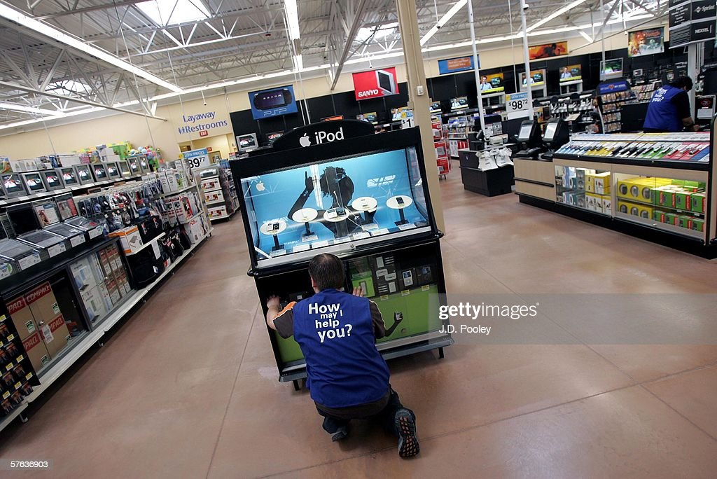 A Wal-Mart employee reaches for an Ipod at the new 2,000 square foot Wal-Mart Supercenter store May 17, 2006 in Bowling Green, Ohio. The new store, one of three new supercenters opening today in Ohio, employs 340 people with 60 percent of those working full-time.