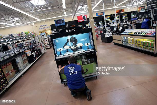 WalMart employee reaches for an Ipod at the new 2000 square foot WalMart Supercenter store May 17 2006 in Bowling Green Ohio The new store one of...