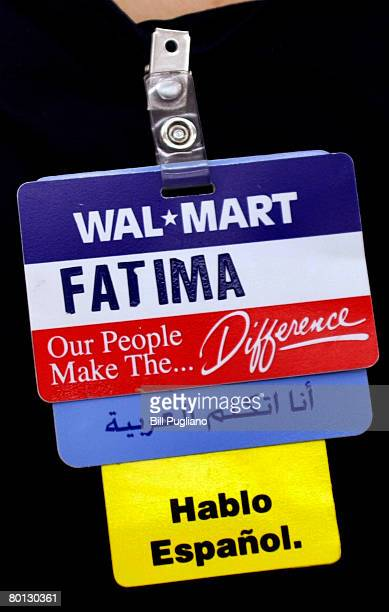 WalMart employee wears a name tag that shows which languages she speaks at a new multilingual WalMart that will stock the largest selection of Middle...