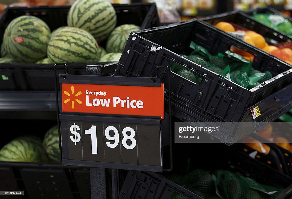 A Wal-Mart Everyday Low Price sign for watermelons and other produce is displayed during the grand opening of a new Wal-Mart Stores Inc. location in Torrance, California, U.S., on Wednesday, Sept. 12, 2012. The Wal-Mart store, which was the first location to open in Los Angeles County since 2006, was built inside of a former Mervyn's clothing location. Photographer: Patrick Fallon/Bloomberg via Getty Images
