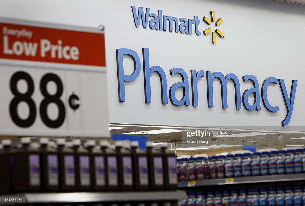 A Wal-Mart Everyday Low Price sign is displayed by the pharmacy during the grand opening of a new Wal-Mart Stores Inc. location in Torrance, California, U.S., on Wednesday, Sept. 12, 2012. The Wal-Mart store, which was the first location to open in Los Angeles County since 2006, was built inside of a former Mervyn's clothing location. Photographer: Patrick Fallon/Bloomberg via Getty Images