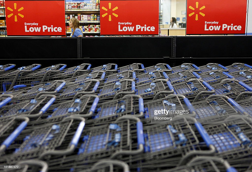 Wal-Mart Everyday Low Price signs are displayed above shopping carts during the grand opening in a new Wal-Mart Stores Inc. location in Torrance, California, U.S., on Wednesday, Sept. 12, 2012. The Wal-Mart store, which was the first location to open in Los Angeles County since 2006, was built inside of a former Mervyn's clothing location. Photographer: Patrick Fallon/Bloomberg via Getty Images
