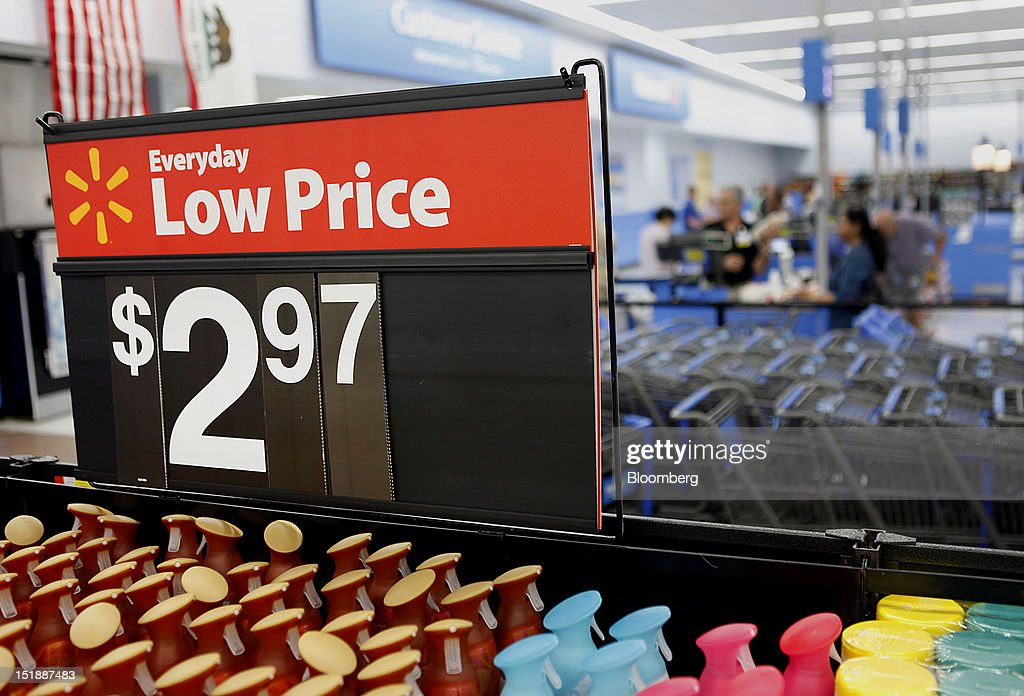 Wal-Mart Everyday Low Price signs are displayed during the grand opening of a new Wal-Mart Stores Inc. location in Torrance, California, U.S., on Wednesday, Sept. 12, 2012. The Wal-Mart store, which was the first location to open in Los Angeles County since 2006, was built inside of a former Mervyn's clothing location. Photographer: Patrick Fallon/Bloomberg via Getty Images