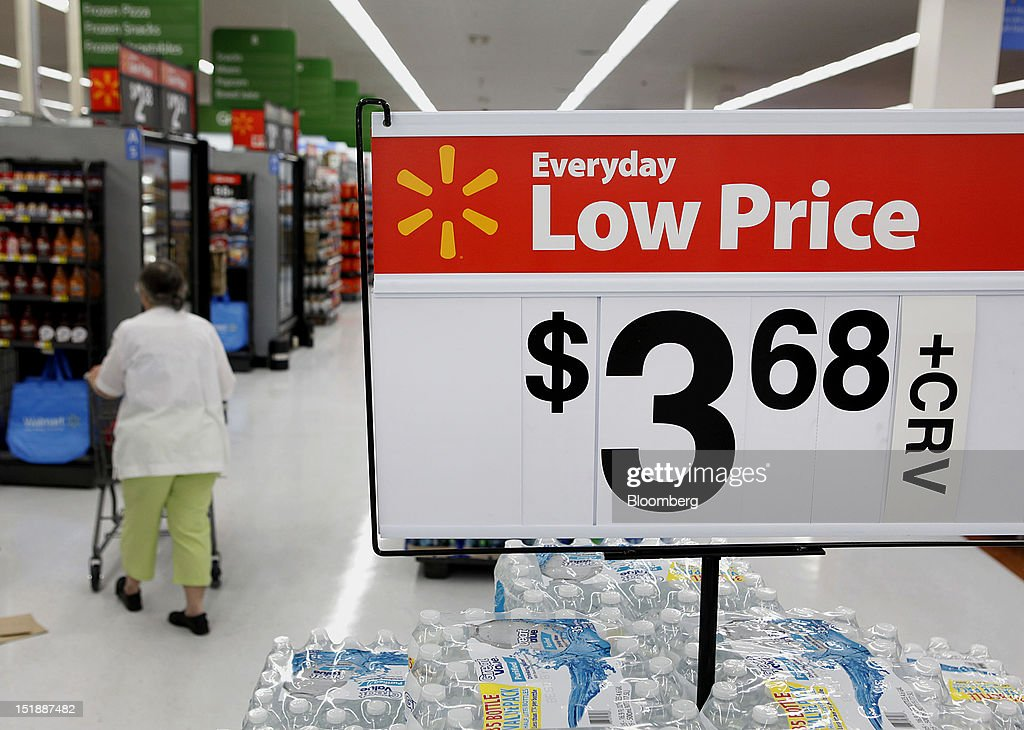 Wal-Mart Everyday Low Price signs are displayed while a customer shops during the grand opening of a new Wal-Mart Stores Inc. location in Torrance, California, U.S., on Wednesday, Sept. 12, 2012. The Wal-Mart store, which was the first location to open in Los Angeles County since 2006, was built inside of a former Mervyn's clothing location. Photographer: Patrick Fallon/Bloomberg via Getty Images