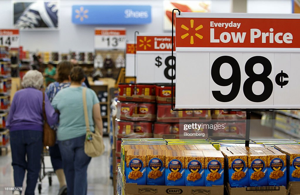 Wal-Mart Everyday Low Price signs are displayed while customers shop during the grand opening of a new Wal-Mart Stores Inc. location in Torrance, California, U.S., on Wednesday, Sept. 12, 2012. The Wal-Mart store, which was the first location to open in Los Angeles County since 2006, was built inside of a former Mervyn's clothing location. Photographer: Patrick Fallon/Bloomberg via Getty Images