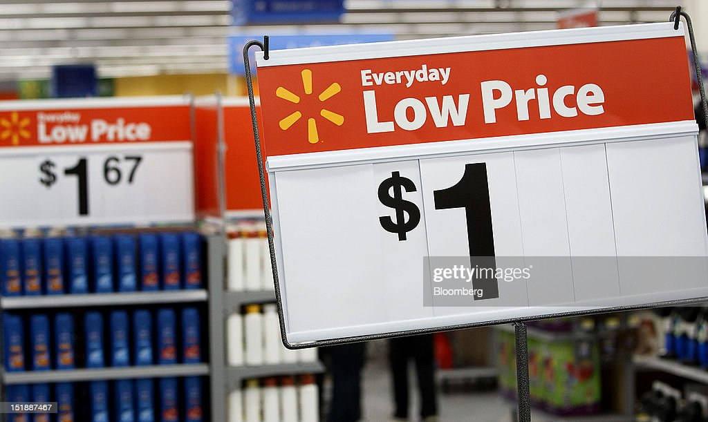 Wal-Mart Everyday Low Price signs is displayed during the grand opening of a new Wal-Mart Stores Inc. location in Torrance, California, U.S., on Wednesday, Sept. 12, 2012. The Wal-Mart store, which was the first location to open in Los Angeles County since 2006, was built inside of a former Mervyn's clothing location. Photographer: Patrick Fallon/Bloomberg via Getty Images