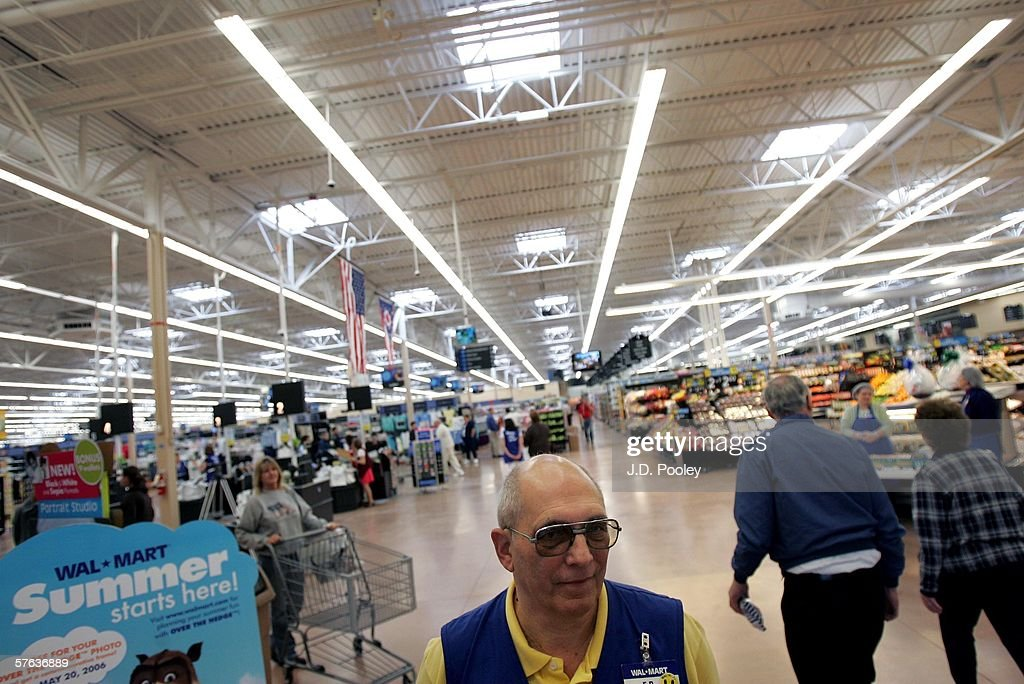 A Wal-Mart greeter is seen welcoming customers into the new 2,000 square foot Wal-Mart Supercenter store May 17, 2006 in Bowling Green, Ohio. The new store, one of three new supercenters opening today in Ohio, employs 340 people with 60 percent of those working full-time.