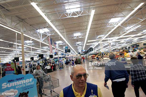 WalMart greeter is seen welcoming customers into the new 2000 square foot WalMart Supercenter store May 17 2006 in Bowling Green Ohio The new store...