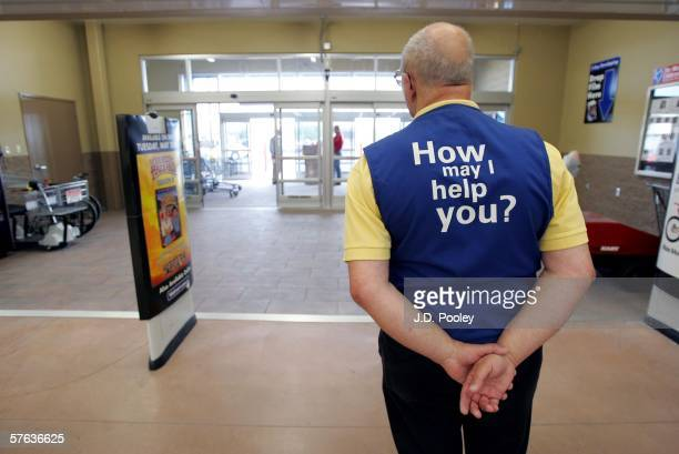 WalMart greeter waits to welcome new customers to the new 2000 square foot WalMart Supercenter store May 17 2006 in Bowling Green Ohio The new store...
