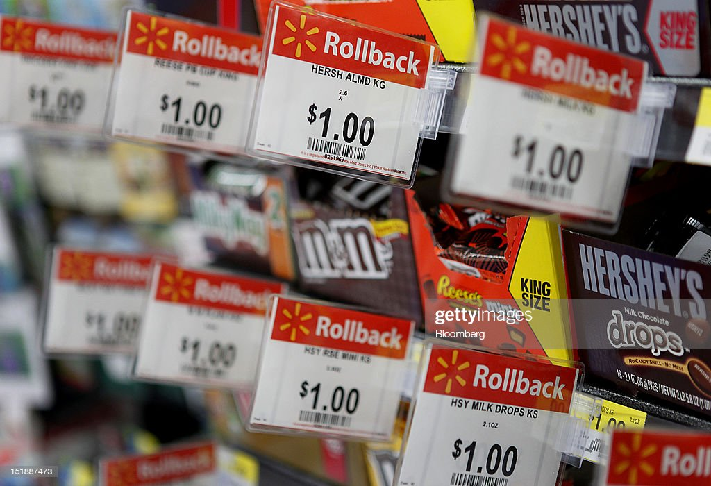 Wal-Mart Rollback pricing signs for Hershey Co. chocolate are displayed during the grand opening of a new Wal-Mart Stores Inc. location in Torrance, California, U.S., on Wednesday, Sept. 12, 2012. The Wal-Mart store, which was the first location to open in Los Angeles County since 2006, was built inside of a former Mervyn's clothing location. Photographer: Patrick Fallon/Bloomberg via Getty Images