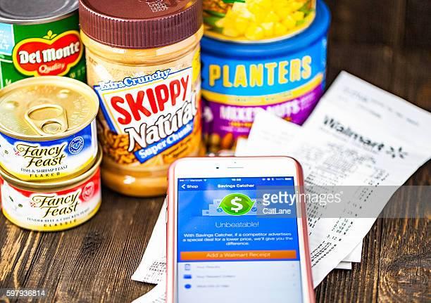 Walmart Savings Catcher App on iPhone screen and assorted groceries