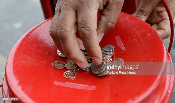 A Walmart shopper drops change into the Salvation Army Kettle in Biddeford Friday Dec 20 2013