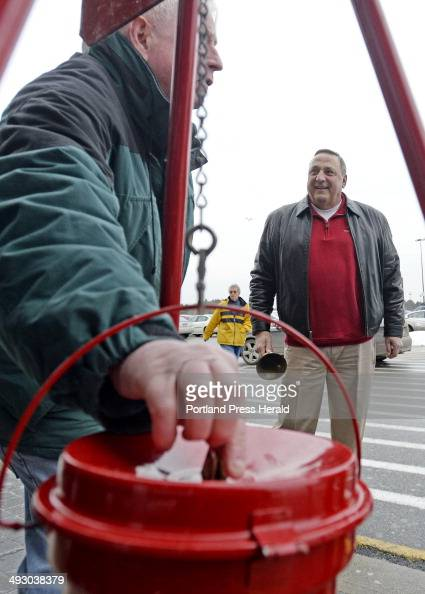 A Walmart shopper drops money into the Salvation Army Kettle as Governor Paul LePage rings the bell out front of Walmart in Biddeford Friday Dec 20...
