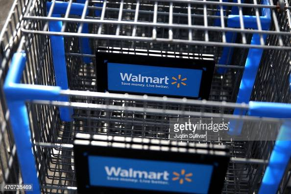 WalMart shopping carts sit outside of a store on February 20 2014 in San Lorenzo California WalMart reporterd a 21 percent decline in fourth quarter...