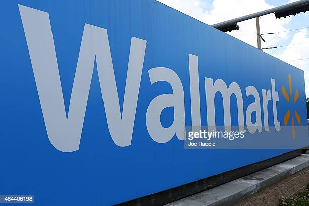 Walmart sign is seen on August 18 2015 in Miami Florida Walmart announced today that earnings fell in the second quarter due to currency fluctuations...