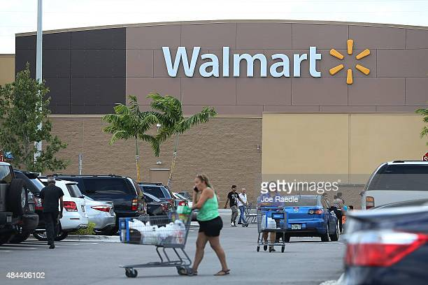 Walmart store is seen on August 18 2015 in Miami Florida Walmart announced today that earnings fell in the second quarter due to currency...