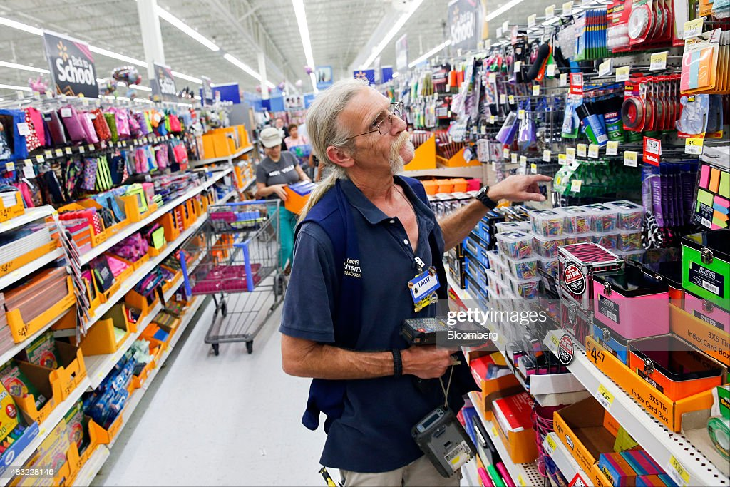 a wal mart stores inc associate checks inventory of school supplies at a wal - Inventory Associate