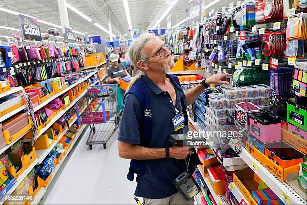 A WalMart Stores Inc associate checks inventory of school supplies at a WalMart Stores Inc location in the Porter Ranch neighborhood of Los Angeles...