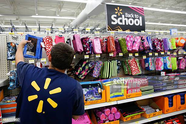 A WalMart Stores Inc associate organizes school supplies at a WalMart Stores Inc location in the Porter Ranch neighborhood of Los Angeles California...