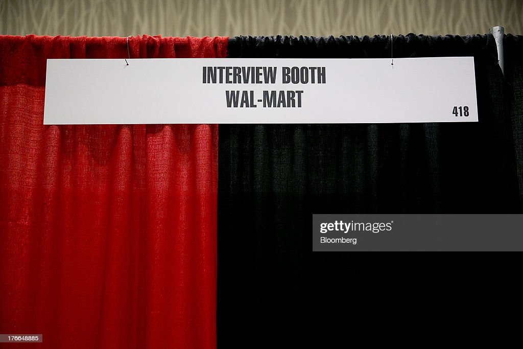 A Wal-Mart Stores Inc. interview booth stands during the Black Data Processing Associates (BDPA) career fair in Washington, D.C., U.S., on Friday, Aug. 16, 2013. The U.S. Department of Labor is scheduled to release initial jobless claims on Aug. 22. Photographer: Andrew Harrer/Bloomberg via Getty Images
