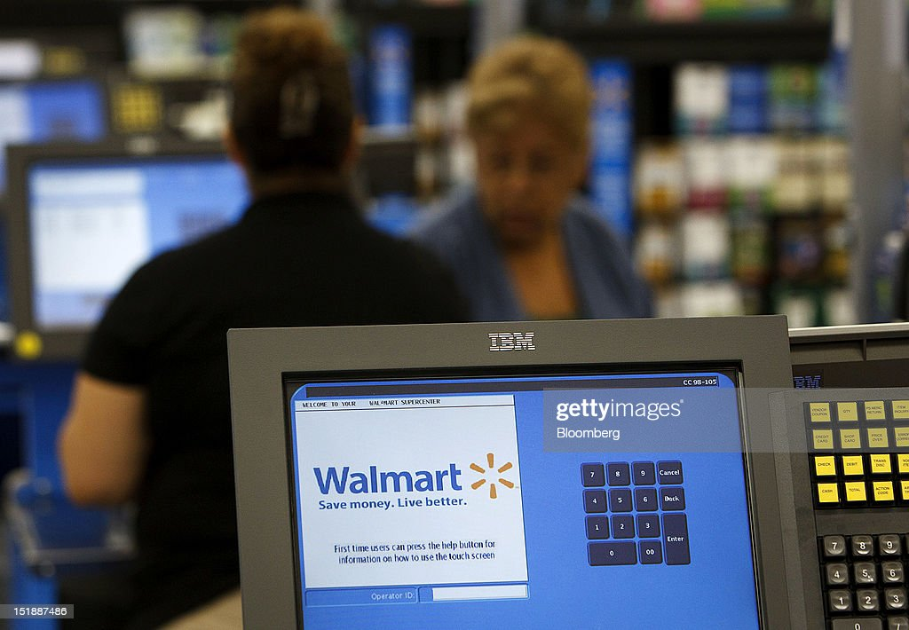 Wal-Mart Stores Inc. signage is displayed on a check out register during the grand opening of a new location in Torrance, California, U.S., on Wednesday, Sept. 12, 2012. The Wal-Mart store, which was the first location to open in Los Angeles County since 2006, was built inside of a former Mervyn's clothing location. Photographer: Patrick Fallon/Bloomberg via Getty Images