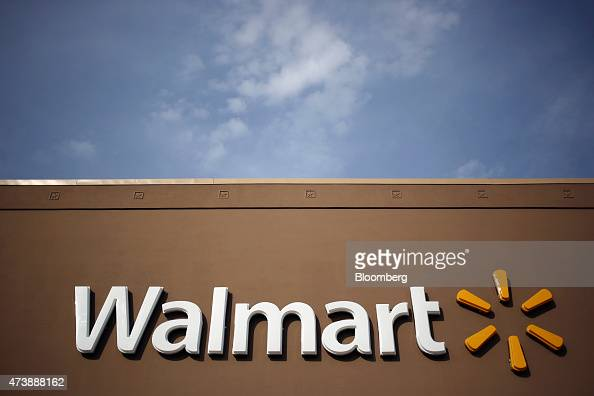 WalMart Stores Inc signage is displayed outside of a store in Louisville Kentucky US on Friday May 15 2015 WalMart Stores Inc is expected to release...