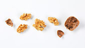 walnut kernels and shells on white background