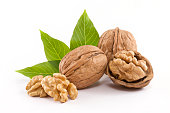 Walnuts with leaf of walnut tree, isolated on white background.