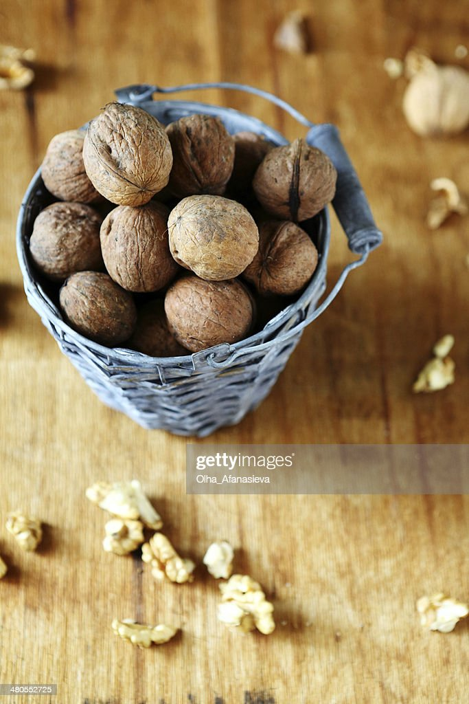 walnuts in an old bucket : Stock Photo