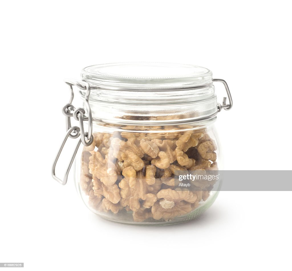 Walnuts in the glass jar : Stock Photo