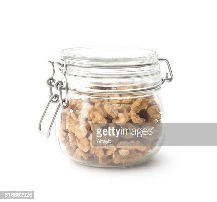 Walnuts in the glass jar : Stock Photo