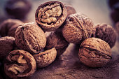 Walnuts on a wooden table in retro style.
